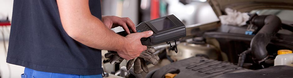 Vehicle diagnostics device being used by a mechanic - Car Diagnostics Southampton